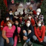 Jr Vets pose with Santa & wear masks to protect from the Thomas Fire smoke. Many of these youth & others would aid Genete in the months ahead working with displaced animals.