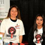 Jr Vets Yadira Solano & Lesly Diaz run the DogE911 booth while Genete teaches a seminar.
