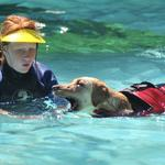 Katie plays with a dog during Splash Days.
