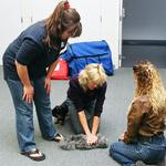 Genete M. Bowen instructing students on animal CPR during a training course. (Nov. 2008)