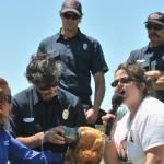 Genete shows firefighters how to give oxygen to pets during critical care times.