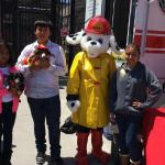 Jr Vets pose with a fire dog & our fire pup Liesel at an event.