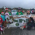 "DogE911 works the parade to advertise for CCSPCA""S annual Santa Paws fundraising function."